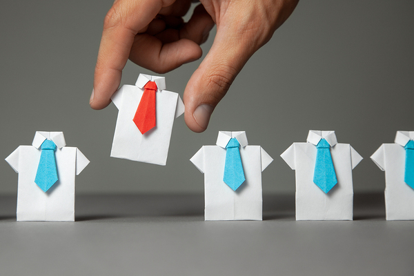 Miniature dress shirts with ties made out of paper.